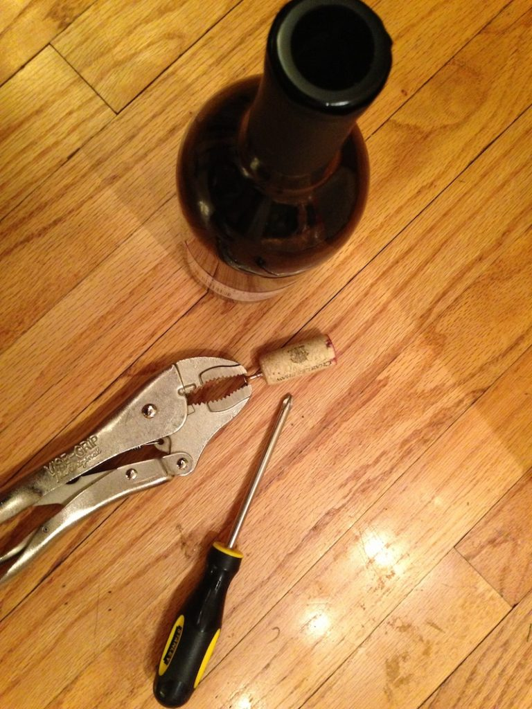 Makeshift wine bottle opener from move day 2013. Because when you need wine, and the real one is buried in one of 100s of boxes...